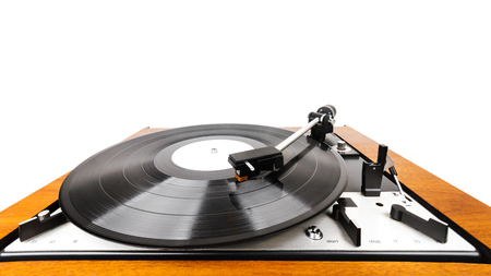 Close up of vintage turntable vinyl record player isolated on white. Retro audio equipment. Tonearm on a record.