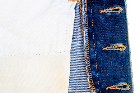 Closeup of jeans fabric with side pocket background. Jeans detail. Blue jeans texture background. Wrong side. Standard-Bild