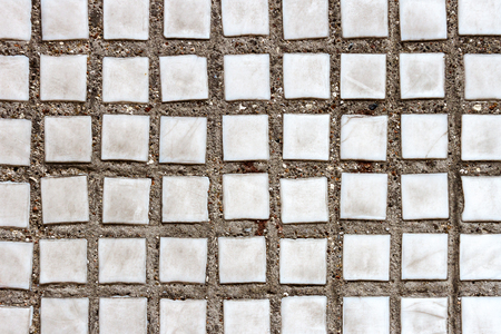 Texture of the old tile wall. Square white small tiles on concrete texture Stock Photo