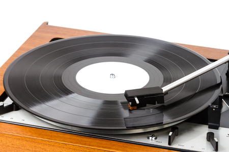 Close up of vintage turntable vinyl record player isolated on white. Wooden plinth. Retro audio equipment. Stock Photo