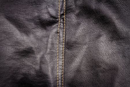 Crumpled black leather texture background. Abstract texture of leather with a seam. Stock Photo - 126809735