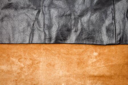 Genuine brown and black leather texture background. Abstract vintage natural cow skins backdrop.