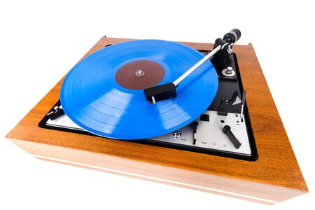 Vintage turntable with a blue vinyl isolated on white. Wooden plinth. Retro audio equipment. Imagens
