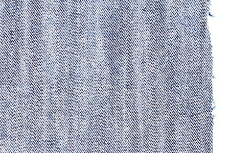 Piece of blue jeans fabric isolated on white background. Rough uneven edges. Denim pants torn. Wrong side of fabric.