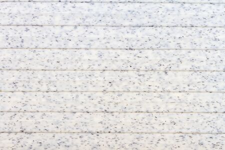 Old white lined plastic tecture background. Plastic texture with some particles. Imagens