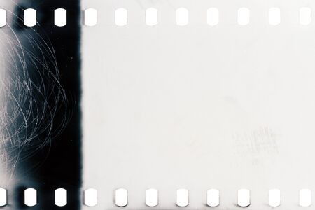 Blank grained film strip texture background Imagens
