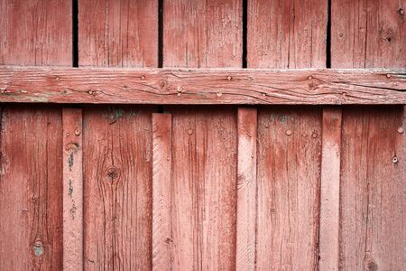 Old wood plank wall texture for background. Wooden wall with nails painted in red