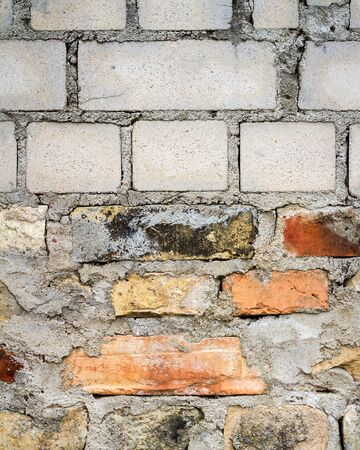 Background of white yellow and red brick wall texture