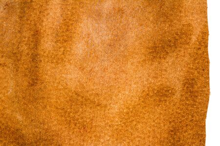 Piece of brown leather isolated on white background Imagens