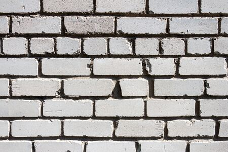 Old white brick wall texture background. This sort of bricks is very common in post soviet countries.