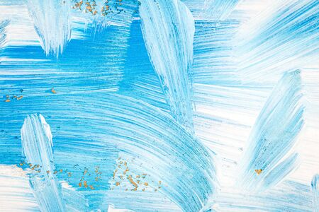 Blue and white abstract art painting on a brown cardboard. Creative abstract hand painted background. Dynamic brush strokes.