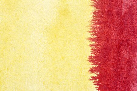 Abstract hand drawn yellow and red watercolor paints background Zdjęcie Seryjne