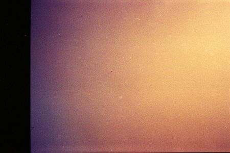 Abstract film texture background with grain, dust and light leak