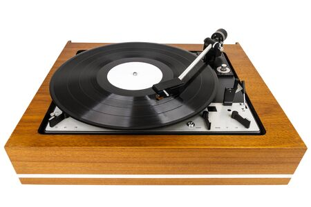 Vintage turntable vinyl record player isolated on white. Wooden plinth. Retro audio equipment.