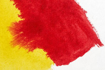 Abstract hand drawn yellow and red watercolor paints background Standard-Bild - 129489376