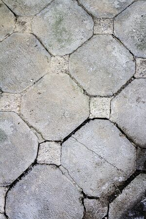 Old concrete tiles in the walkway. Abstract architecture background