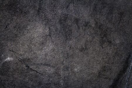 Crumpled black leather texture background. Abstract texture of leather with a seam. Back side 版權商用圖片