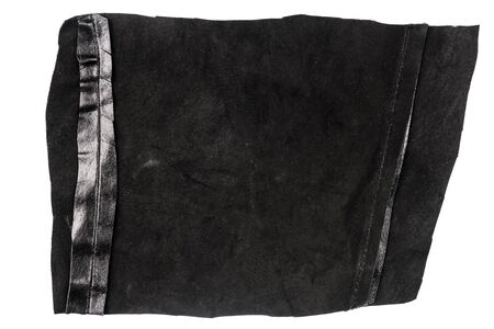 Piece of black leather isolated on white background. Crumpled material texture. Back side