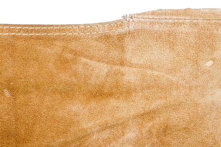 Piece of brown leather isolated on white background Фото со стока