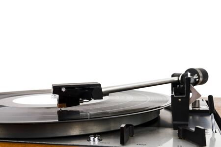 Close up of turntable needle on a vinyl record. Turntable playing vinyl. Needle on rotating black vinyl.
