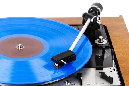 Vintage turntable with a blue vinyl isolated on white. Wooden plinth. Retro audio equipment. 版權商用圖片