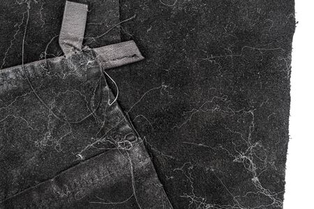 Piece of messy black leather isolated on white background. Crumpled material texture. Back side