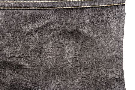 Piece of brown leather isolated on white background. Crumpled material texture.