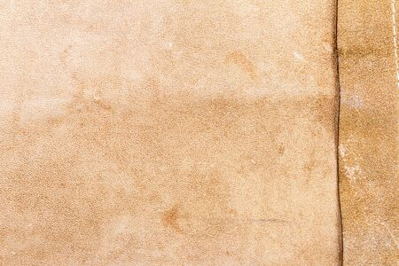 Genuine brown leather texture background. Abstract vintage natural cow skin backdrop. Wrong side of leather. 版權商用圖片