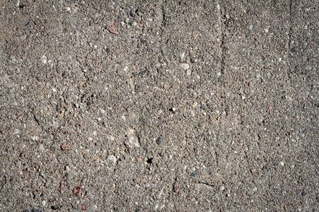Close up of old concrete texture. Weathered concrete with some stones. 版權商用圖片