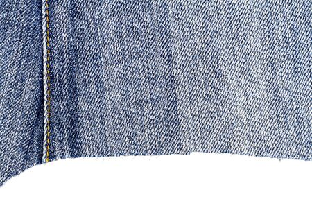 Piece of light blue jeans fabric isolated on white background. Rough uneven edges.