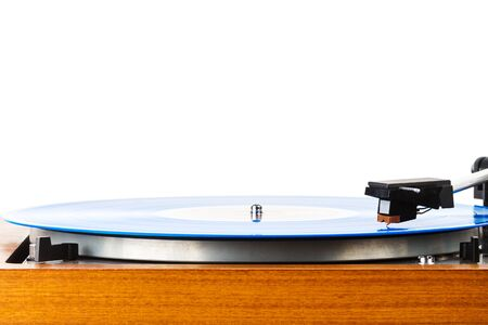 Close up of vintage turntable vinyl record player isolated on white. Wooden plinth. Retro audio equipment. 版權商用圖片