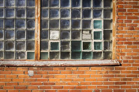 Red brick wall with glass block window. Architecture detail. Banque d'images - 133059225