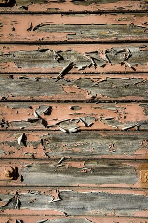 Peeling brown paint on weathered wood texture. Abstract architecture background 版權商用圖片