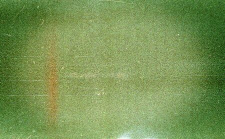 Green filmstrip texture background with heavy grain and dust