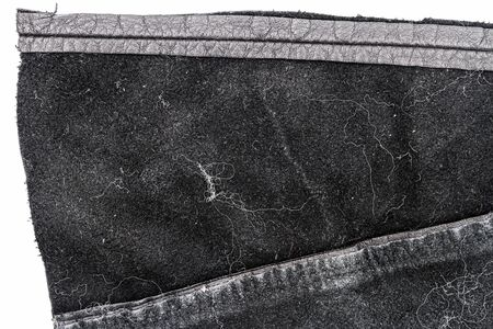 Piece of messy black leather isolated on white background. Crumpled material texture. Back side Standard-Bild