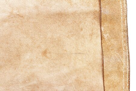Piece of brown leather isolated on white background. Back side.
