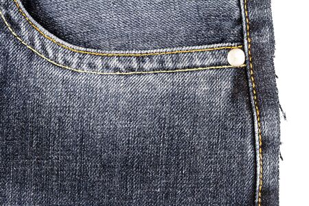Piece of black jeans fabric with a side pocket isolated on white background. Rough uneven edges. Denim jeans torn 免版税图像