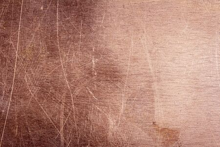 Scratched dirty dusty copper plate texture, old metal background. Cloudy and scratchy copper metal texture.