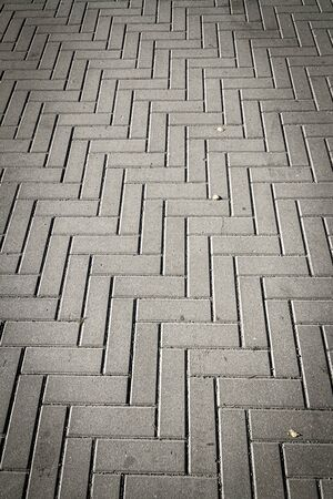 Concrete tiles in the walkway. Abstract architecture background
