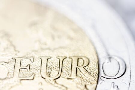 Two euro coin macro detail with euro word. 2 euro coin macro view. European currency extreme close up. Фото со стока