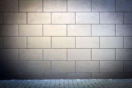 Modern dark tile wall and concrete sidewalk 版權商用圖片