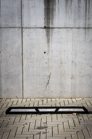 Gray concrete wall and parking space.