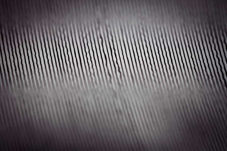 Macro shot of black vinyl record. Surface of an old vinyl record. Shallow deph of field. Banco de Imagens