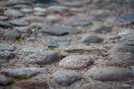 Closeup shot of old cobblestone with low deph of field. 版權商用圖片