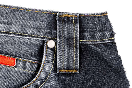 Piece of black jeans fabric with a side pocket isolated on white background. Rough uneven edges. Denim jeans torn 版權商用圖片