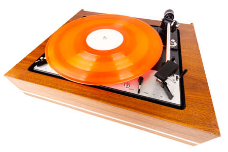 Vintage turntable with a red vinyl isolated on white. Wooden plinth. Retro audio equipment. 版權商用圖片