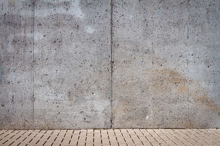Gray concrete wall and parking space. 版權商用圖片