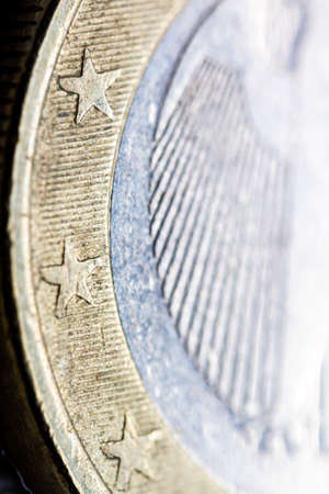 Two euro coin macro detail with German Coats of arms detail . German 2 euro coin macro view. European currency extreme close up. Shallow depth of field.