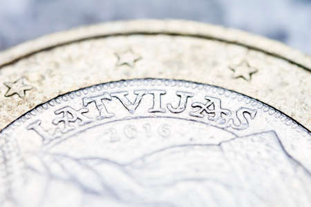 Two euro coin macro detail with Latvijas word. Latvian 2 euro coin macro view. European currency extreme close up. Shallow depth of field.