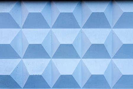 Blue decorative plaster. Wall stucco texture. Geometric background